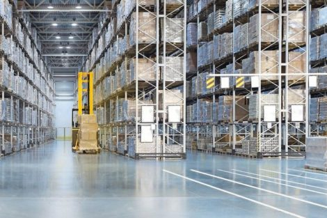 Huge_distribution_warehouse_with_high_shelves_and_loaders._Bottom_view.