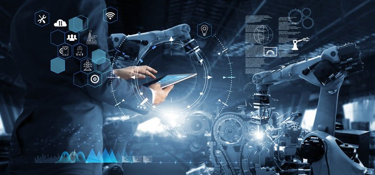 Manager_Technical_Industrial_Engineer_working_and_control_robotics_with_monitoring_system_software_and_icon_industry_network_connection_on_tablet._AI,_Artificial_Intelligence,_Automation_robot_arm