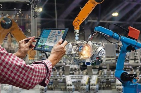 Engineer_touch_screen_control_robot_the_production_of_factory_parts_engine_manufacturing_industry_robots_and_mechanical_arm