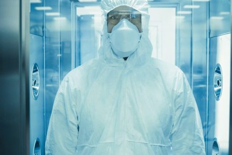 _Factory_Worker_in_Coverall_Suit_Disinfects_Himself_in_Decontamination_Shower_Chamber._Biohazard_Emergency_Response.