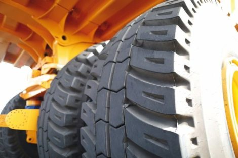 Huge_rear_wheels_of_dump_truck_at_unusual_angle_closeup