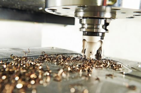 industrial_metalworking_machining_cutting_process_of_blank_detail_by_milling_cutter_with_hardmetal_carbide_insert_at_modern_cnc_machine.