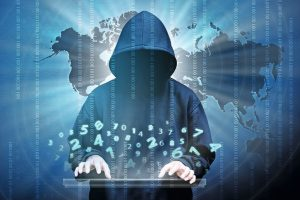 Computer_hacker_silhouette_of_hooded_man_with_binary_data_and_network_security_terms