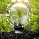 Trees_that_are_growing_in_bulbs_front_of_global_show_the_world's_consumption_with_icons_energy_sources_for_renewable,_sustainable_development._Ecology_concept.