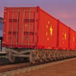 train_with_containers_with_the_flag_of_China_driving_near_the_buildings_of_the_logistics_center