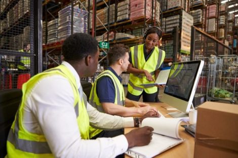 Team_discussing_warehouse_logistics_in_an_on-site_office