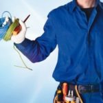 Background_with_uniformed_electrician_with_tools_and_electrical_equipment_and_blue_background_with_effect_of_lights._Front_view._Horizontal_composition.