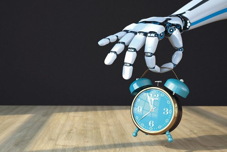White_hand_of_the_robot_with_classic_alarmer_on_the_wooden_table._3d_illustration.