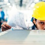 Supervisor_doing_quality_control_and_pruduction_check_in_metal_factory
