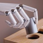 Robotic_Hand_with_Cylinder_and_Shape_Sorting_Toy_Closeup._Machine_Learning_and_Recognition_Concept_3d_Illustration