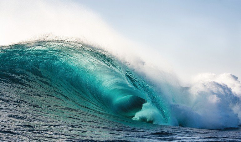 Big_wave_barrel_unloads_in_the_surf.