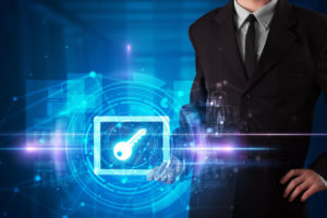 Hand_holding_tablet_with_online_security_and_data_protection_concept_