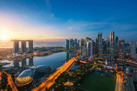 Aerial_view_of_Singapore_business_district_and_city_at_twilight_in_Singapore,_Asia.
