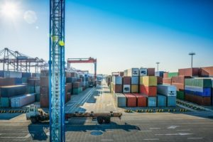 Container_loading_in_a_Cargo_freight_ship_with_industrial_crane._Container_ship_in_import_and_export_business_logistic_company._Industry_and_Transportation_concept.
