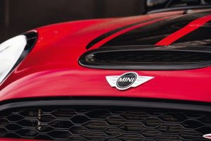 Vallelunga,_Italy_september_24_2017._Red_mini_cooper_car_front_logo_view_clean_shiny_closeup_with_brand_name