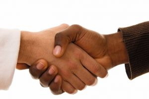 Black_and_white_hands_shaking_in_friendly_agreement_isoalted_on_white