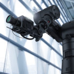 3d_rendering_black_robot_hand_with_camera_or_robotic_camera__