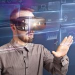 Amazed_businessman_with_virtual_reality_charts_and_data_in_front_of_him