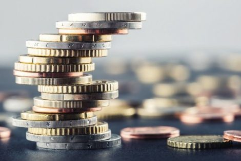 Euro_coins._Euro_money._Euro_currency.Coins_stacked_on_each_other_in_different_positions._Money_concept.